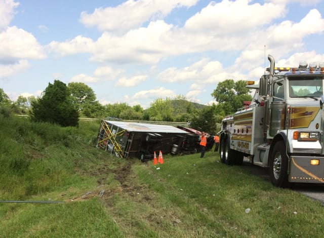 An overturned tractor trailer is about to be towed by Lisi's Towing Company early Monday afternoon near the I-684/I-84 interchange in Brewster.