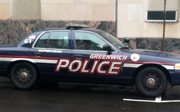 A Town of Greenwich Parks and Recreation employee has been charged after he allegedly brandished a weapon at a fellow employee during a Friday morning dispute.