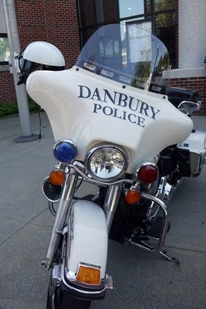 Danbury Police charged three men with several drug offenses following a bust on Harrison Street.
