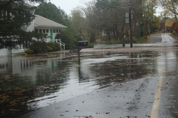 Five Mile River Road in Darien floods during Hurricane Sandy.