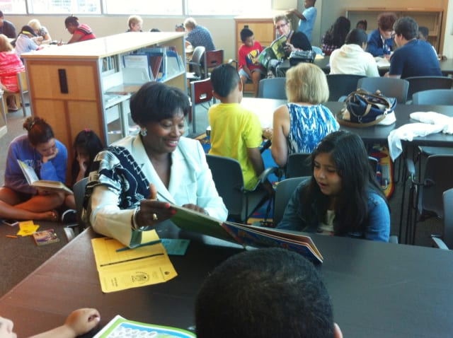 State Sen. Andrea Stewart-Cousins reads one-on-one with a second-grader at the Yonkers Public Library.