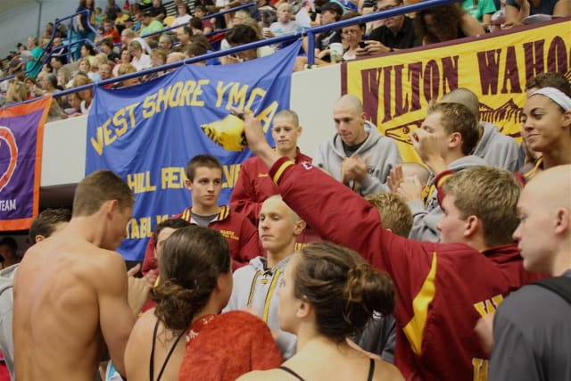 Wilton Wahoos team members get charged up to swim at the Long Course Nationals in Indianapolis.