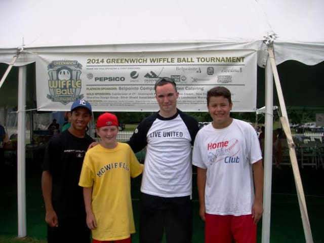 Brendan Mick, left, a Wiffle event organizer for the United Way, with a team of young players at the 2014 Town Wiffle Tourney.