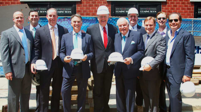 At the Summer House steel construction celebration are (from left) William Feeser, David Hirschberg, Ken Senior, Thomas L. Rich, Mayor David Martin, Alan Silverman, Stephen McDonald, Alex Silverman, Gordon Clough and Andrew Silverman.