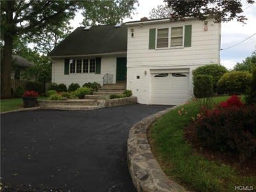 This house at 50 Hickory Hill Road in Eastchester is open for viewing on Sunday.