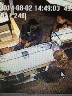 This is an image from the surveillance camera at a Stamford Town Center jewelry store. The man in the wheelchair stole a Rolex and pepper-sprayed an employee and a security guard, police said.