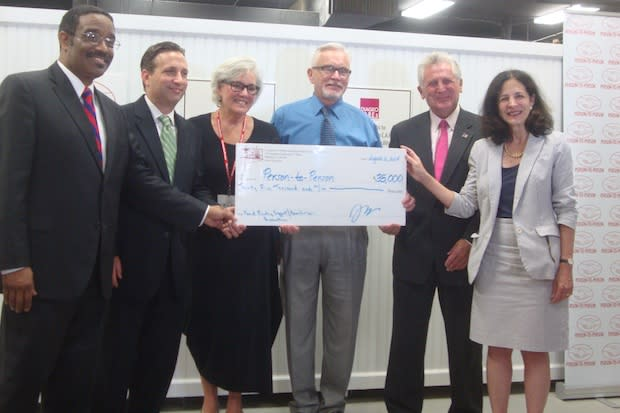 Rep. Bruce Morris, Sen. Bob Duff, Person-to-Person Executive Director Ceci Maher, CHEFA Executive Director Jeffrey Asher, Mayor Harry Rilling and Rep. Gail Lavielle celebrate CHEFA's $35,000 grant to Person-to-Person in Norwalk.