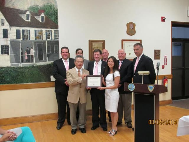 "The Village Board of Trustees and Elmsford Mayor Robert Williams present Johshin Honzan, left front, and his World Seido Karate dojo with a declaration making Aug. 6 ""World Seido Karate Day"" in the village."