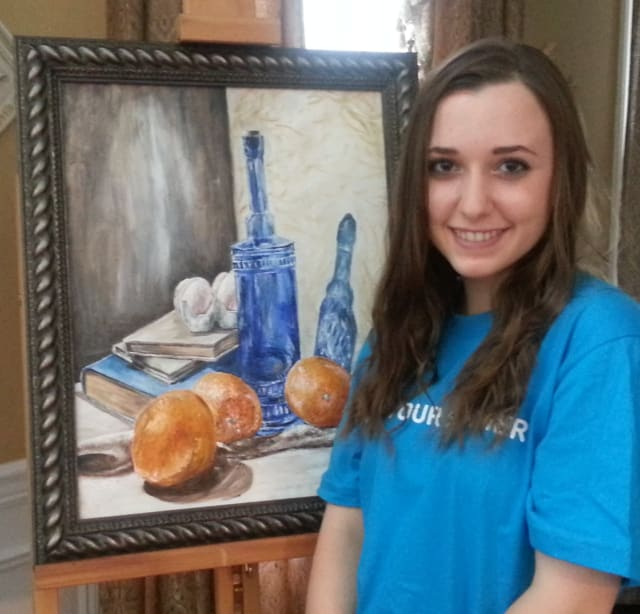 Becca Raffo with one of art pieces that will be displayed at the Somers Library.