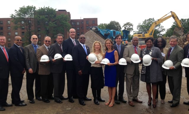 Rella Fogliano (Center) breaks ground with dignitaries at the construction site of Phase II of the Heritage Homes housing development.