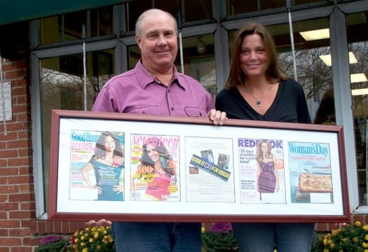 Tom and Anne Geary hold a display of magazine covers with the Click It For Cassie advertisement that appeared across the nation in 2011.