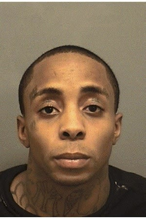 Richard Garrison, 33, was charged in the 2011 robbery of David Harvey Jewelers in Darien.