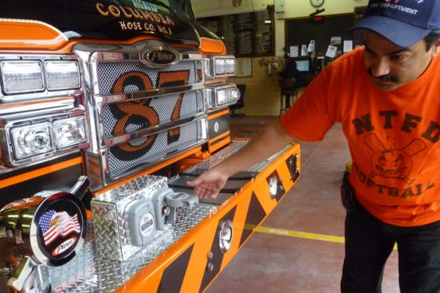 Capt. Carlos Romero shows off Sleepy Hollow's new fire truck and its attachment for the Fire Department's extrication tool.
