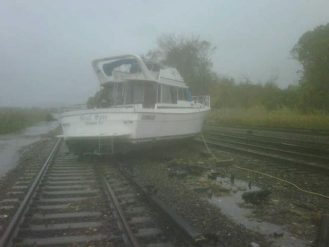 A boat washed up onto train tracks in Ossining Tuesday morning due to Hurricane Sandy.