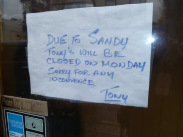 Signs like this one at a Hastings restaurant have cropped up in the windows of local businesses still without power.