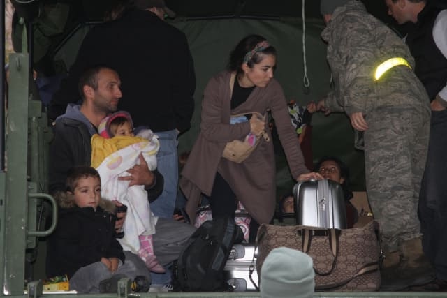 National Guardsmen help residents after Hurricane Sandy.