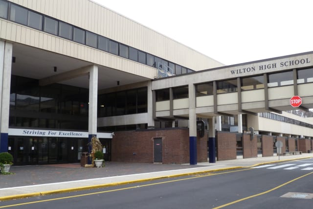 Wilton High School and the town's other public schools will remain closed on Monday as the town continues cleaning up and restoring power lost during Hurricane Sandy.