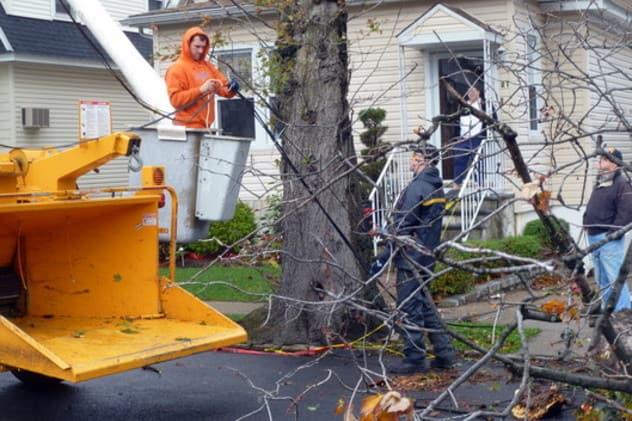 Crews work to restore downed power lines in Yonkers last week.
