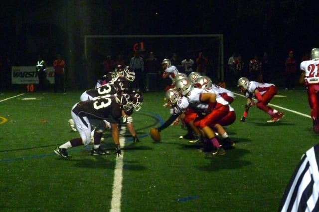 The Sleepy Hollow High School football team (in white) will face Somers in the Section 1 Class A finals Saturday.