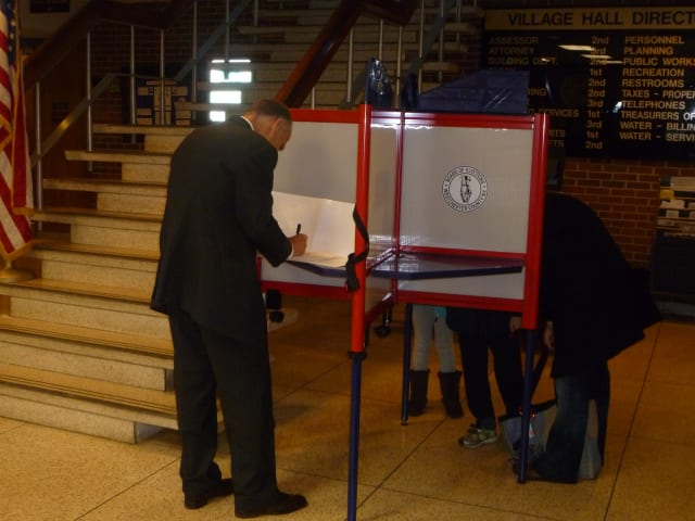 A Scarsdale voter casts his vote Tuesday at Village Hall.