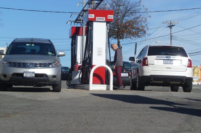 Cars were filling up at Harrison's Citgo station Thursday.