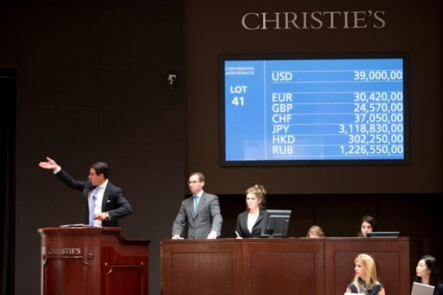 "Christie's auctioneer Andreas Rumbler hammers down Claude Monet's ""Nymphéas,"" which achieved the second highest price for the artist at $43.8 million."