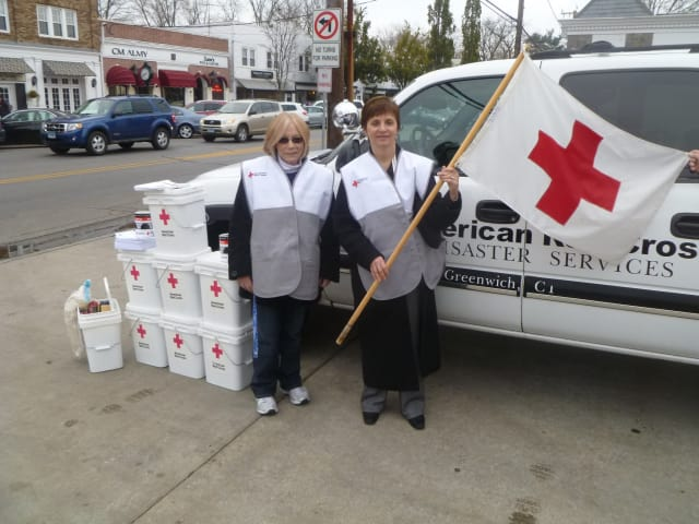 Greenwich Red Cross volunteers gave out clean-up kits Saturday at the Sound Beach Volunteer Fire Company.