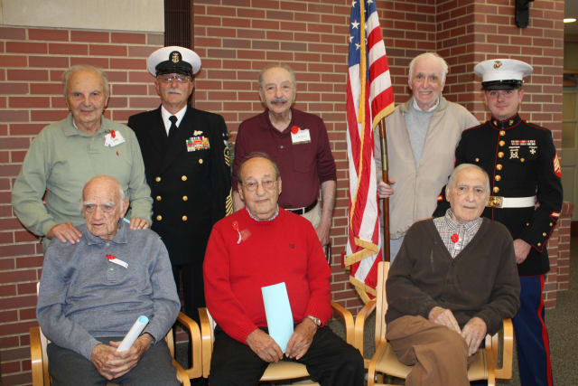 Joseph Minkiewicz, Nate Lindabury; Navy Master Chief Richard Iannucci; Tony Cipri, Angelo Burno, Joseph Mossa, Emillio Lupinacci, and Marine Sgt. Michael Bennedetto.