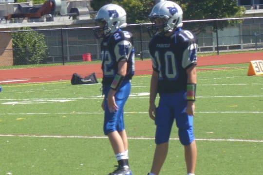 Matthew Cerminaro, 10, and Timmy Jacobi helped the Fairfield Wildcats' seventh-grade football team reach the league semifinals.