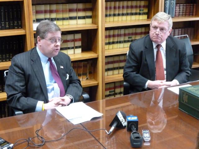 (From L to R) Westchester legislators Peter Harckhman (D-Katonah) and William Ryan (D-White Plains) react to County Executive Robert Astorino's budget proposal Wednesday.