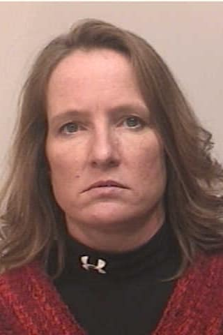 Cheryl Patton-Lynch, 46, of Chester, was charged with identity theft and other charges by Fairfield police Thursday.