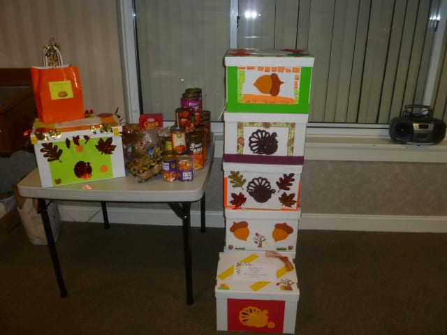 Colorful Thanksgiving gift boxes filled with holiday food items are being distributed by the Covenant Church of Easton.