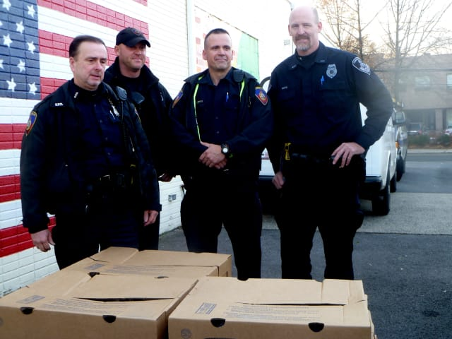 From left: Officers Peter McManus, Erik Soderholm and John O'Meara and Lt. Mike Noto drop off gobblers to the Food Bank of Lower Fairfield County.