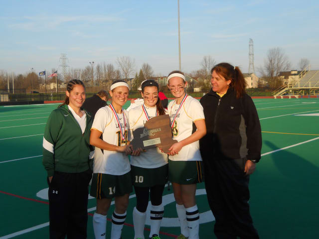 Lakeland captains, from left, Gianna Bensaia, Rebeeca Bard and Kristen Conroy with assistant coach Jenna Wenkl, left, and coach Sharon Sarsen, right. The captains played on the four consecutive Lakeland state-champion teams from 2009-12.
