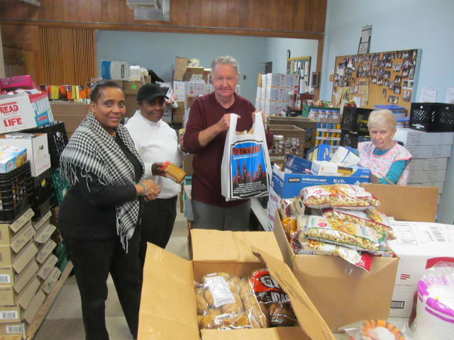 Volunteers for HOPE Community Services in New Rochelle work on Sunday to prepare for the Thanksgiving holiday in the organization's food pantry.