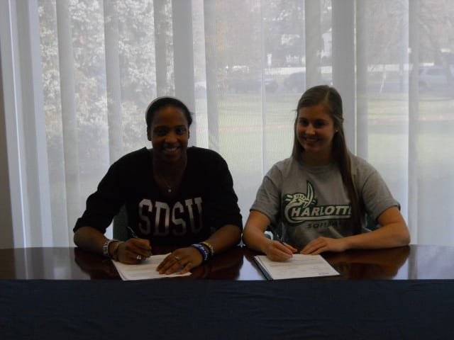 Ursuline's Alyssa Lawrence, left, and Brittany Mitchell, prepare to sign their respective college national letter of intent Monday. Lawrence signed to attend San Diego State, and Mitchell will be going to the University of North Carolina-Charlotte.