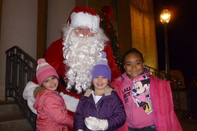 Madelyn, left, and Kaitlyn Dwyer, center, along with Jayla Odtis help welcome Santa last year at the festivities in Depot Square in Tuckahoe.