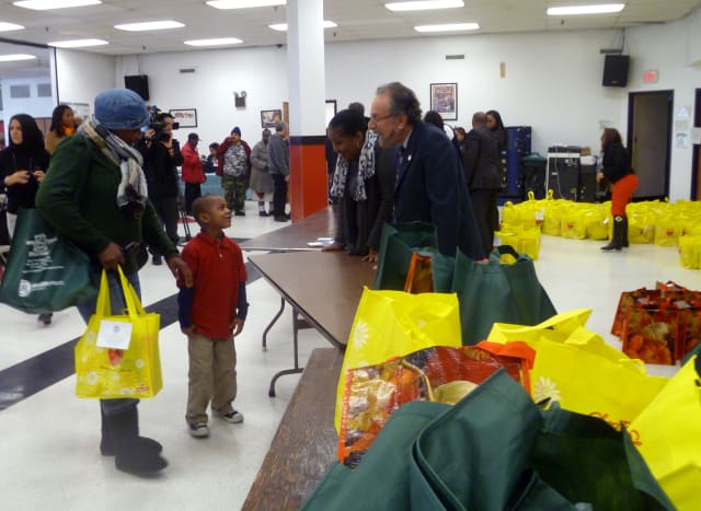City Councilman Michael Sabatino hands out turkeys Tuesday at the Nepperhan Community Center in Yonkers.