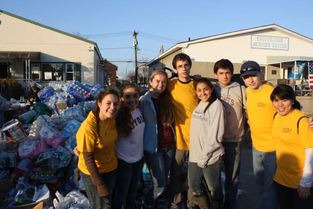 Eight Yonkers students were part of a group from the Loyola School in Manhattan who recently traveled to Queens to hep with Hurricane Sandy cleanup.