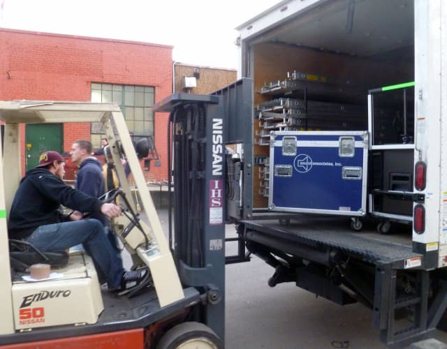 Crews from Sound Associates Inc., in Yonkers load the final pieces of sound equipment Tuesday in preparation for Macy's Thanksgiving Day Parade.