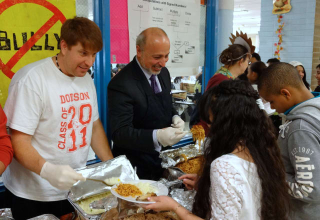 Yonkers Superintendent of Schools Bernard Pierorazio attended the Thanksgiving feast at Dodson School to serve the students.