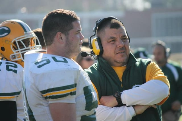 Trinity Catholic football coach Pete Stokes talks with Riley Kinahan during the win over Wilton.