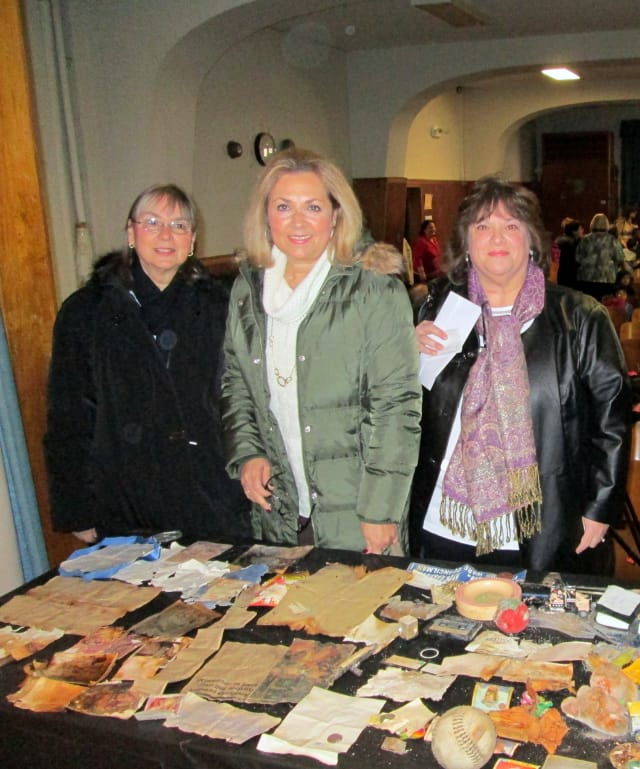Lorry Skrobola, Andrea Bernardi and Barbara Branca, left to right, all returned to the Yonkers school to view the items from the time capsule buried in 1987.