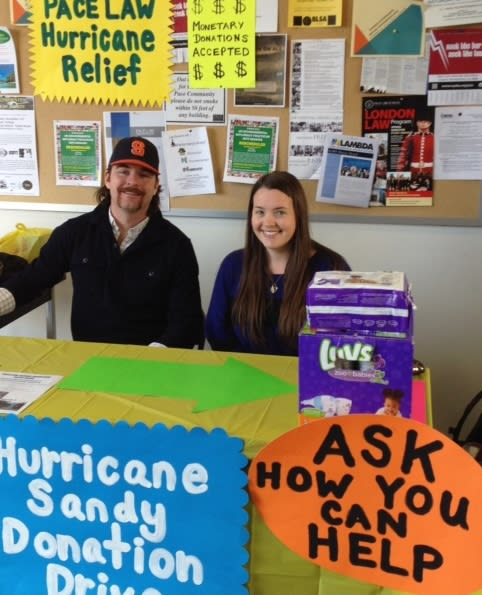 Patrick VanHall (left) and Kiera Fitzpatrick (right) collect supplies and money for Hurricane Sandy victims at Pace Law School in White Plains.