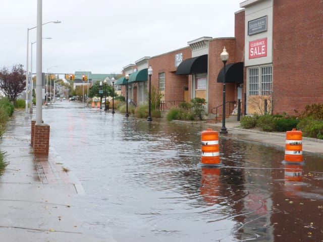 Flooded Water Street in South Norwalk during Hurricane Sandy. Gov. Dannel Malloy is requesting $3.2 billion in federal aid for infrastructure improvements.