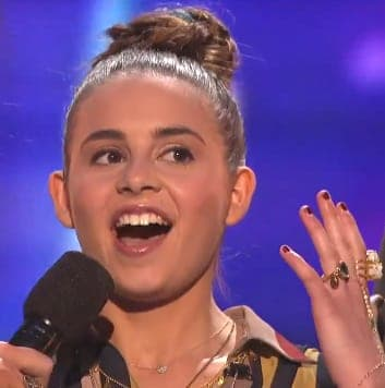 "Mamaroneck teenager Carly Rose Sonenclar held onto the top spot on ""X Factor"" Thursday night."