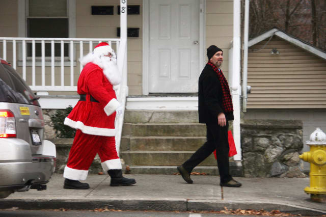 Gregory Schmidt , co-chair of the Croton Business Council, accompanies Santa to the tree-lighting ceremony.