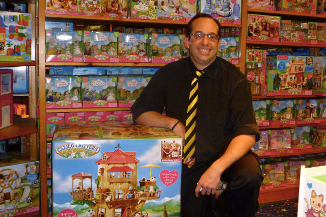 Andrew Lev, manager of Smart Kids Toys in Greenwich, displays some Calico Critters, which have been among his hottest-selling toys this holiday season.