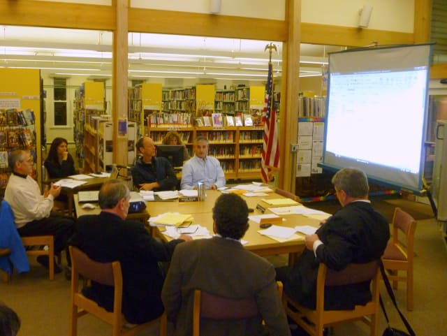 Town Comptroller Leo Masterson, far left, presents the 2013 budget at Monday's Town Board meeting.