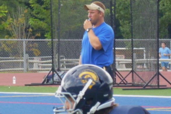 Weston football coach Joe Lato watches the team at practice earlier this year.